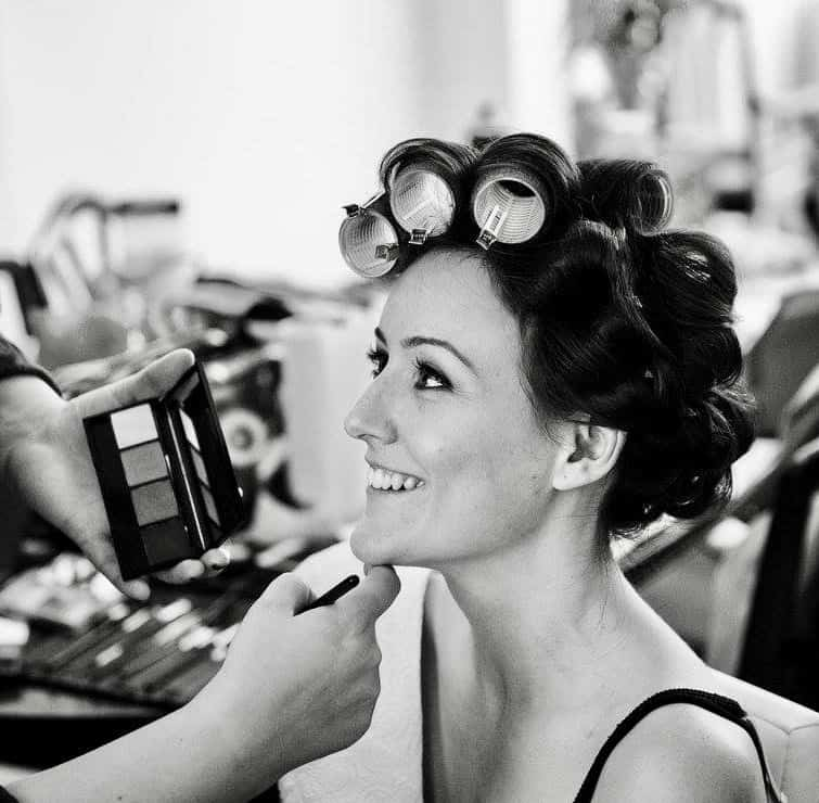 Black and white shot of bride with hair in rollers